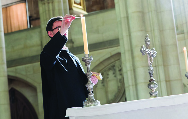 Br John lights candle in Downside Abbey Church