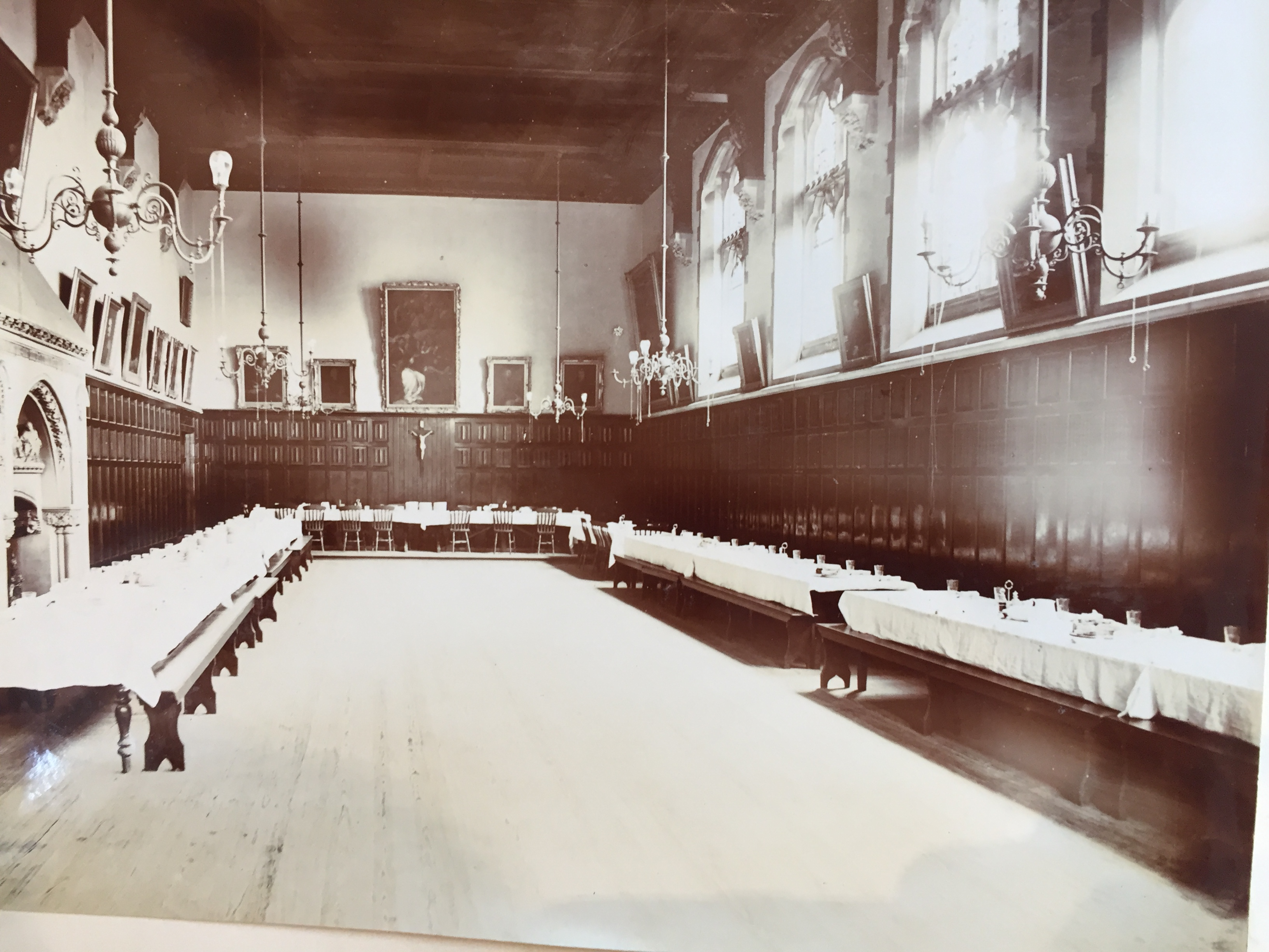 Old black and white image of hall in monastery