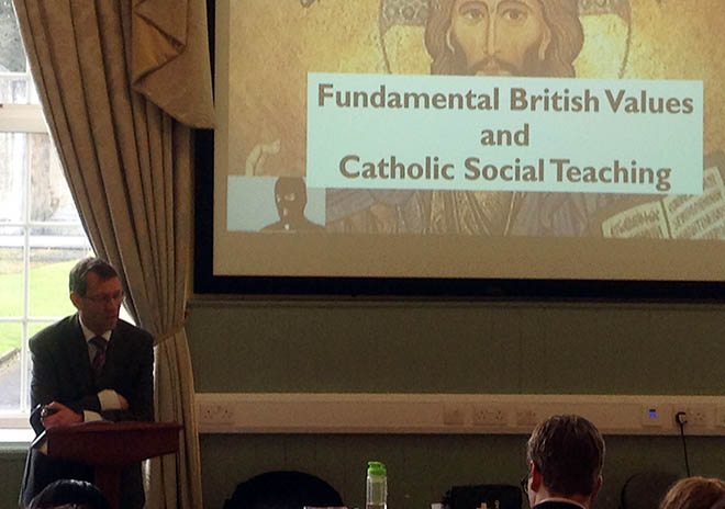 Man presenting fundamental british values and catholic social teaching slideshow