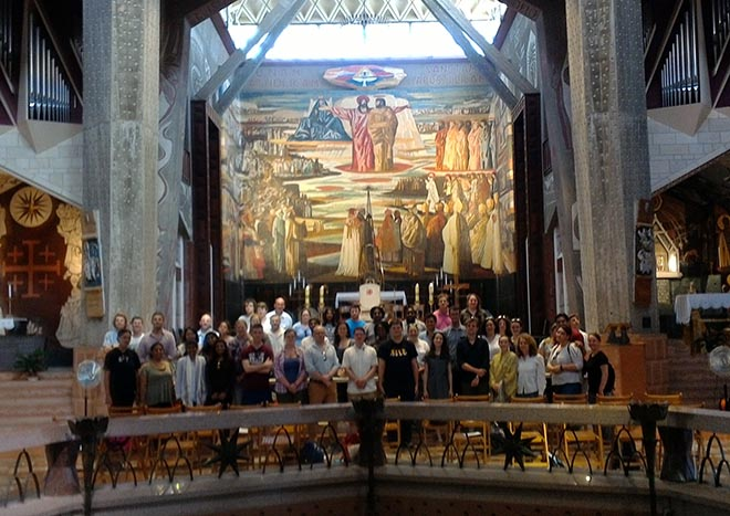 Group stood in front of mural inside church