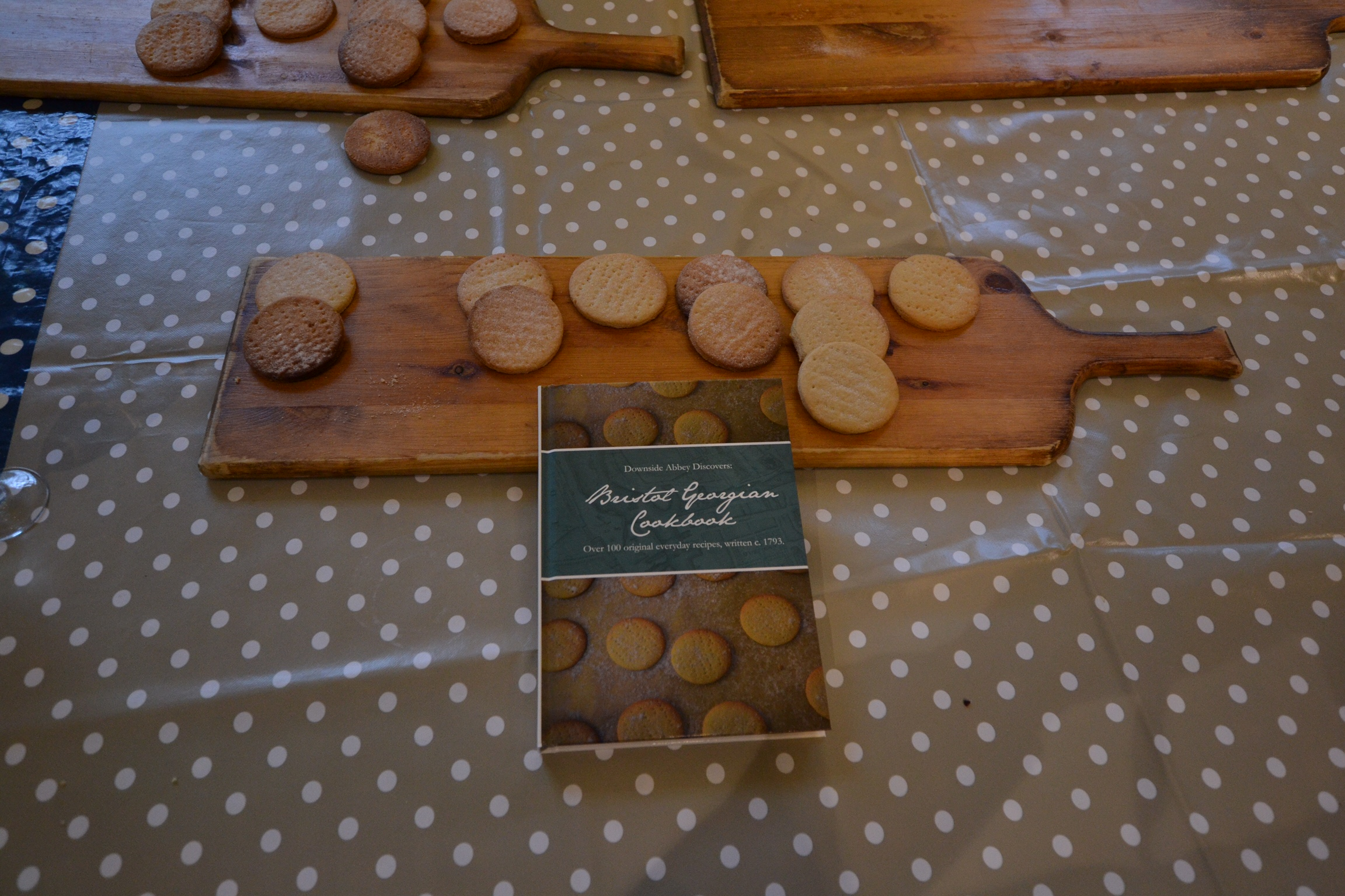 Biscuits on board next to cookbook